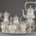A SEVEN PIECE KURZ & CO. HANAU SILVER TEA AND COFFEE SERVICE AND TRAY